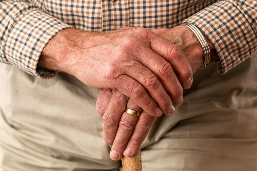 Elderly hands with a ring